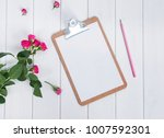 clipboard with blank paper and... | Shutterstock . vector #1007592301
