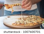 man cutting slices of authentic ... | Shutterstock . vector #1007600701