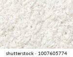 coconut flakes background. top... | Shutterstock . vector #1007605774