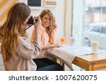 showcase cafe two girl drinking ... | Shutterstock . vector #1007620075