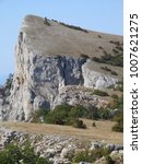 Small photo of A highly elevated cliff (cuesta) with the abrupt, and gentle back slopes. The southern mountainous landscape: forest-steppe and scarp rocky slopes