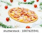 hawaiian pizza with pineapple... | Shutterstock . vector #1007625541