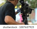 rear side of video cameraman... | Shutterstock . vector #1007637925