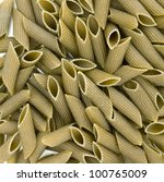 Green colored penne pasta. Food background - stock photo