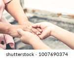 close up old and young hand of... | Shutterstock . vector #1007690374