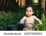 1 year old asian boy get riding ... | Shutterstock . vector #1007698501