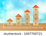 wood block houses and stacks of ...   Shutterstock . vector #1007700721
