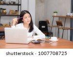asian young woman working... | Shutterstock . vector #1007708725