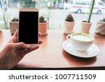 close up of men  hands holding... | Shutterstock . vector #1007711509