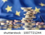 tower with euro coins and flag... | Shutterstock . vector #1007721244