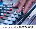 close up hands sound mixer... | Shutterstock . vector #1007743459