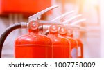 red tank of fire extinguisher... | Shutterstock . vector #1007758009