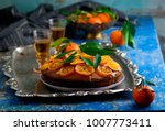madeira cake with caramelised... | Shutterstock . vector #1007773411