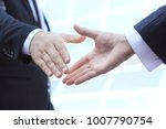 image of a firm handshake | Shutterstock . vector #1007790754