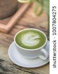 hot green tea latte  in white... | Shutterstock . vector #1007804275