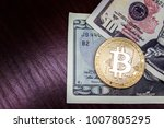 gold coin bitcoin next to the...   Shutterstock . vector #1007805295