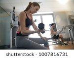 athletic girl in fitness room... | Shutterstock . vector #1007816731