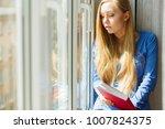 young woman sitting on...   Shutterstock . vector #1007824375