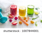 fresh juices and gym equipment... | Shutterstock . vector #1007844001