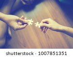 two hands trying to connect... | Shutterstock . vector #1007851351