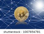 macro shot of golden bitcoin ...   Shutterstock . vector #1007856781