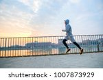 a handsome young man running in ... | Shutterstock . vector #1007873929