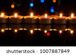 single lit candles.candles new... | Shutterstock . vector #1007887849