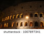 view at roman coliseum at night....   Shutterstock . vector #1007897341