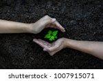 hands kids team work protecting ... | Shutterstock . vector #1007915071
