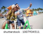 young couple riding bikes in... | Shutterstock . vector #1007934511