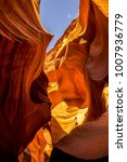 Small photo of Geological formation of the Lower Canyon of Antelope, Arizona, USA. Narrow stone labyrinth and blue sky