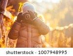 boy using digital camera taking ... | Shutterstock . vector #1007948995