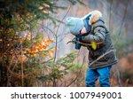 boy using digital camera taking ...   Shutterstock . vector #1007949001