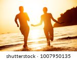 silhouettes of happy couple... | Shutterstock . vector #1007950135