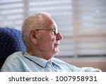 portrait of smiling old man in... | Shutterstock . vector #1007958931