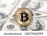 golden bitcoin coin on dollars. ...   Shutterstock . vector #1007960599