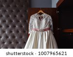 wedding dress hanging on the... | Shutterstock . vector #1007965621