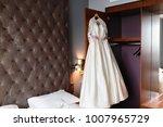 wedding dress hanging on the... | Shutterstock . vector #1007965729