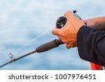 asian man hand holding a...   Shutterstock . vector #1007976451
