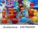 multicolored glass vessels at... | Shutterstock . vector #1007984509