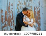 beautiful happy couple posing... | Shutterstock . vector #1007988211