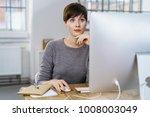 thoughtful business woman... | Shutterstock . vector #1008003049