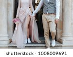 Small photo of Stylish marriage couple get out of the church together. Wedding clothes. Wedding idea.