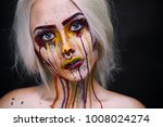 painted pretty woman face | Shutterstock . vector #1008024274