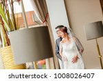 the bride and groom stand in... | Shutterstock . vector #1008026407