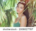 tropical girl listening to... | Shutterstock . vector #1008027787