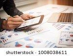 businessman pen pointing graph...   Shutterstock . vector #1008038611