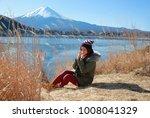 girl sitting near the fuji...   Shutterstock . vector #1008041329