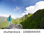 woman stand at top of mountain   Shutterstock . vector #1008044455