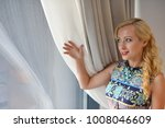 young woman looking through...   Shutterstock . vector #1008046609